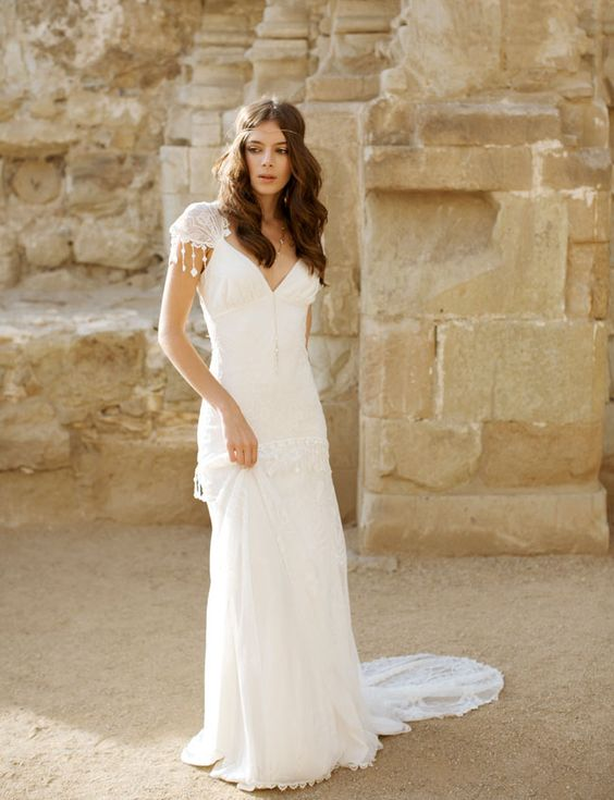 boho Moroccan wedding dress with a V neck, lace cap sleeves and a boho headpiece