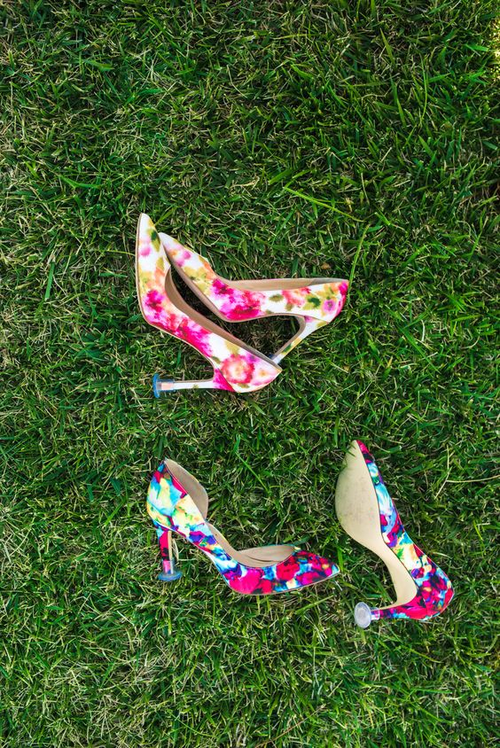 bold floral wedding shoes for both brides to rock