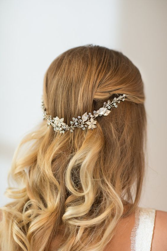 half up half down hairstyle with a hair vine of crystals and white flowers
