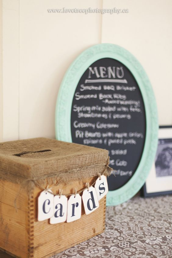 rough wooden box with a burlap cover and a banner