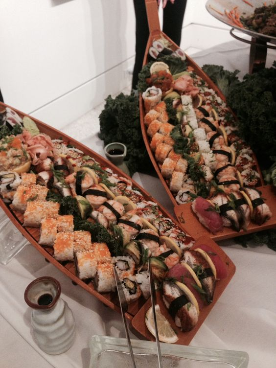 wooden canoe-styled plates and boards for serving sushi