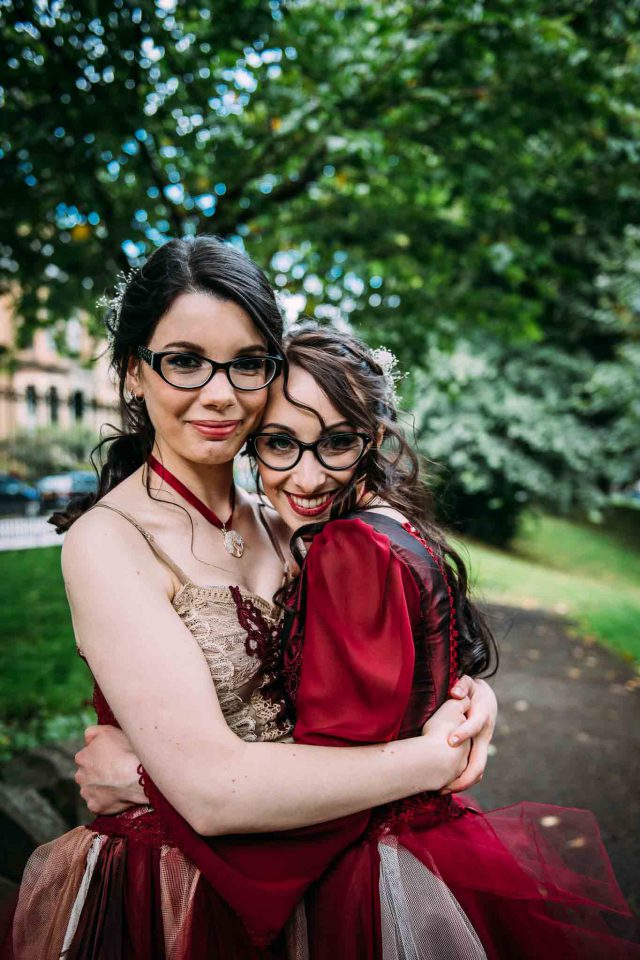 Both brides were wearing similar wavy hairstyles and glasses, so they looked very similar