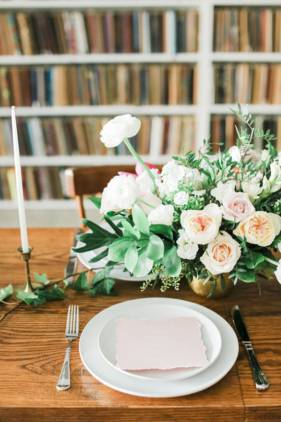 Candles and soft pastel flower bouquets with blush cards were used for table decor