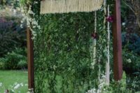 06 arch with macrame, hanging greenery and bold flowers