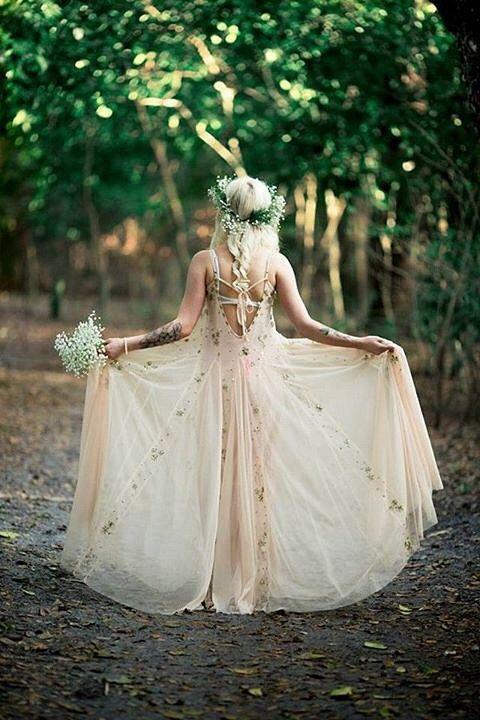 boho blush wedding dress on straps, a braid and a baby's breath crown