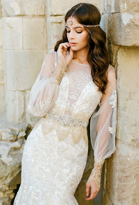 lace sheer sleeves and an illusion neckline wedding dress with an embellished sash and a boho headpiece with beads
