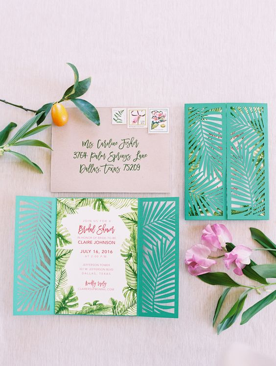leaves and laser cut bold green invites look cool