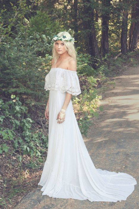 off the shoulder wedding dress with a lace trim and a flower crown