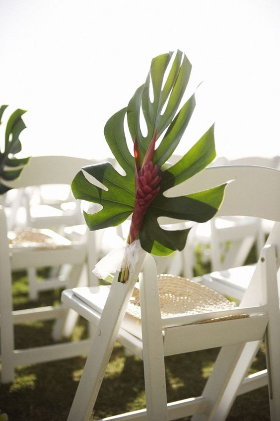 palm leaves and monstera wedding chair decor