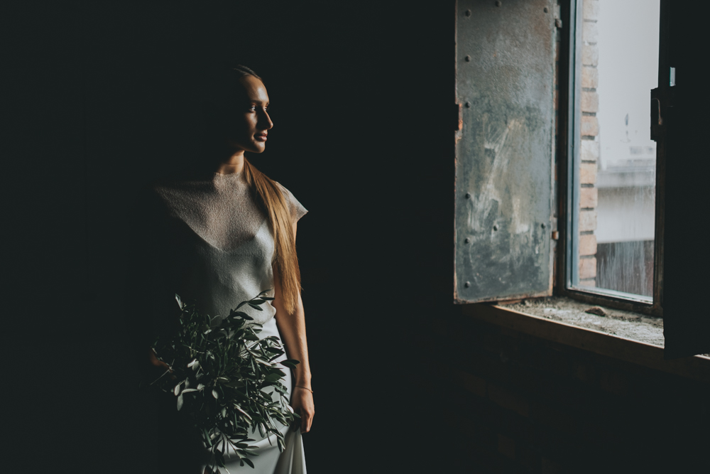 The bride was wearing simple plain dresses with modern cuts and a sleek hairstyle