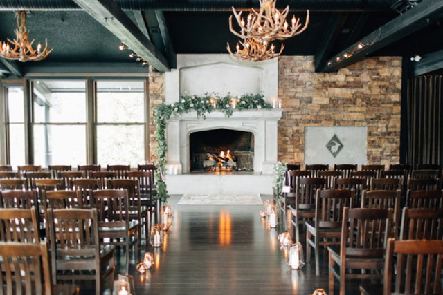 The ceremony spot was decorated with geometric candle lanterns, antler chandeliers and greenery garlands