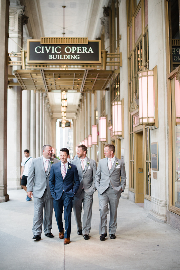 The groomsmen were wearing grey suits, and the groom was rocking blue