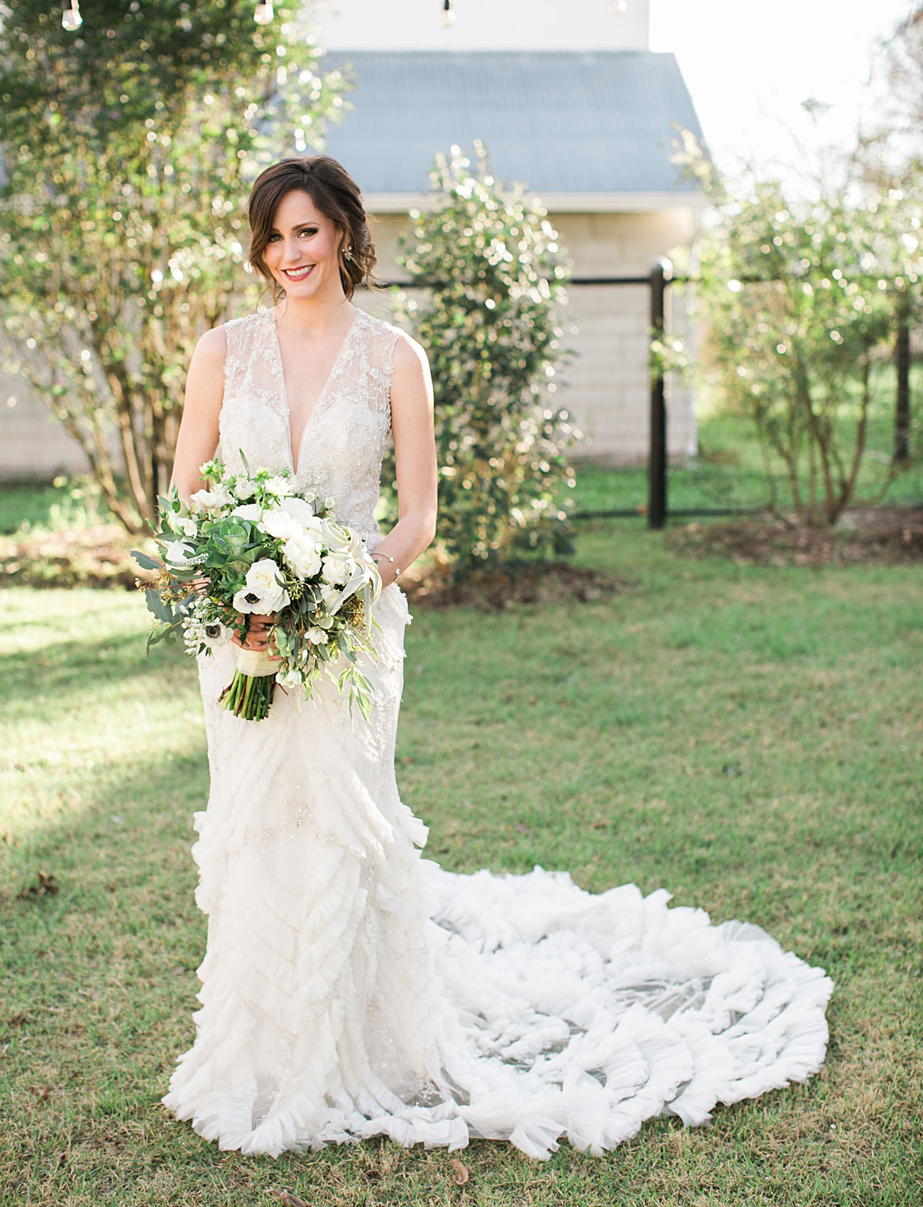 The wedding bouquet was neutral and textural, and worked perfectly with the dress