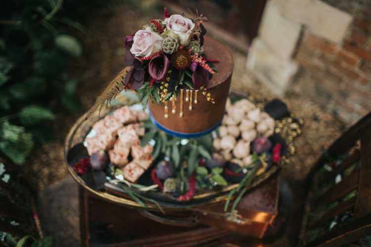 The wedding cake was done in brown with drip, which is a hot trend, and topped with moody flowers