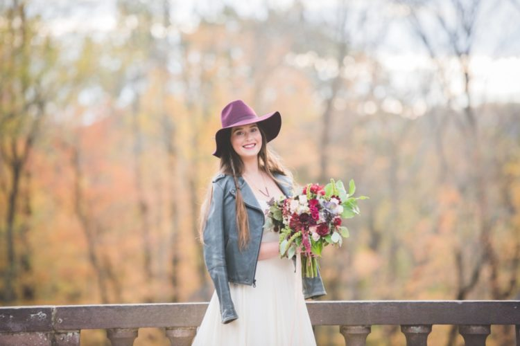 Wear a cool leather jacket and a purple hat with your romantic dress