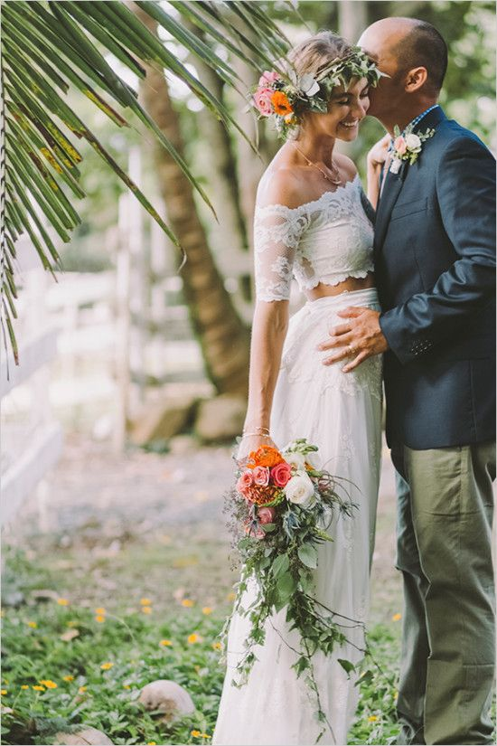 a lace off the shoulder bridal separate with a long skirt and a flower crown for a boho tropical bride