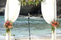 07 a wWood wedding arch with draping fabric and flowers in peach and coral