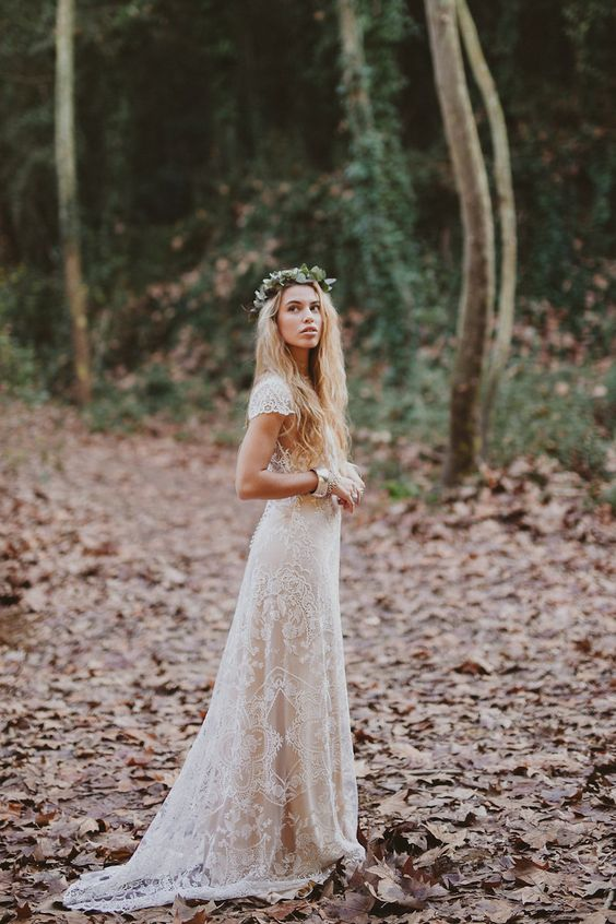 boho-inspired ivory lace wedding dresss with cap sleeves and a leaf crown