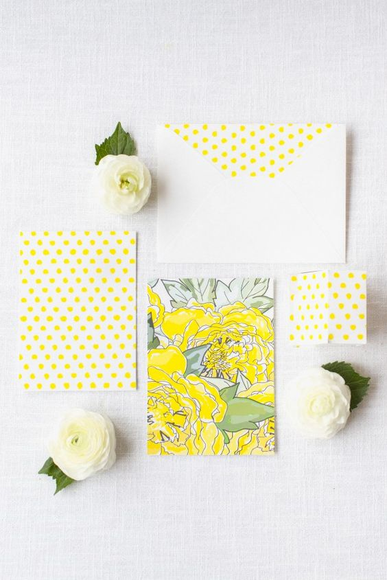 bold yellow polka dot wedding stationary and floral prints