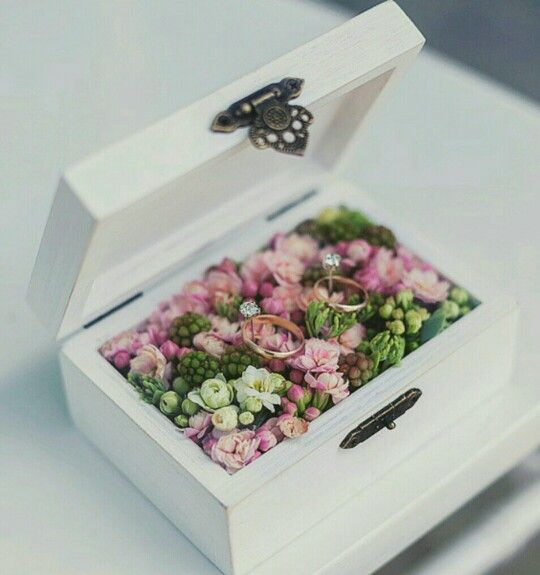 chic white box filled with fresh flowers