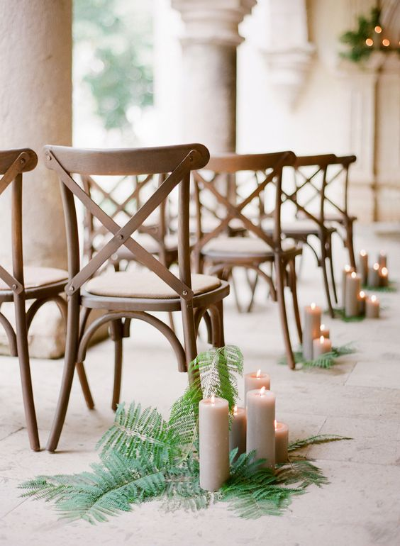 fern and candles for wedding aisle decor