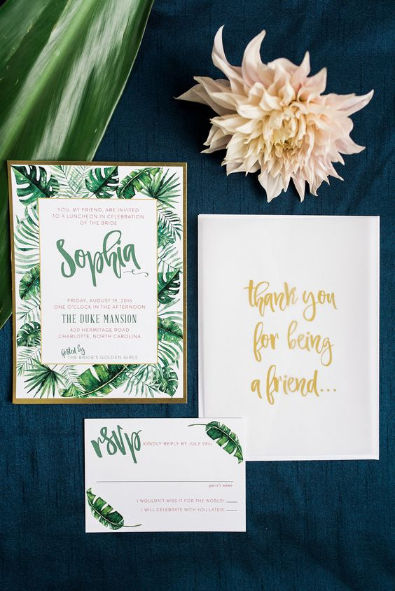 palm and banana leaf wedding stationary with calligraphy