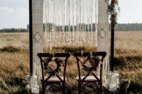 07 stunning macrame wedding arch with floral accents and hanging crystals