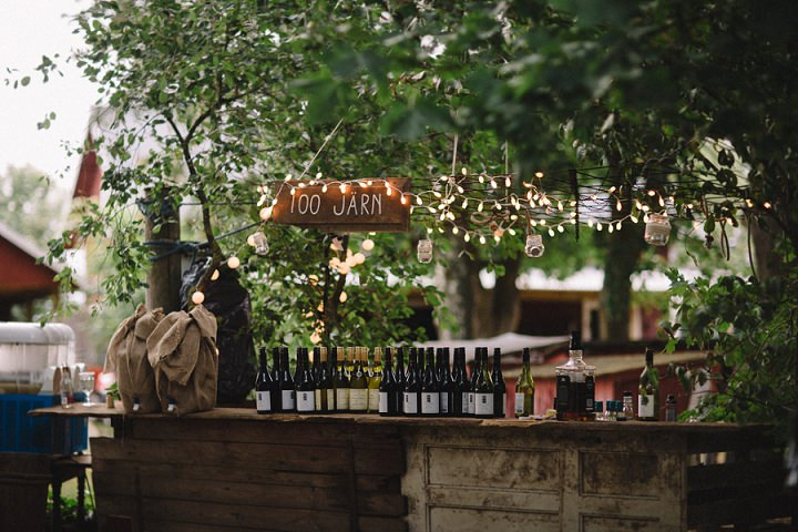 Lights, greenery,burlap were used for wedding decor to make it cozier
