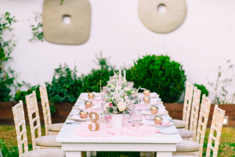 The bride chose a very romantic pink and gold wedding color scheme for the wedding