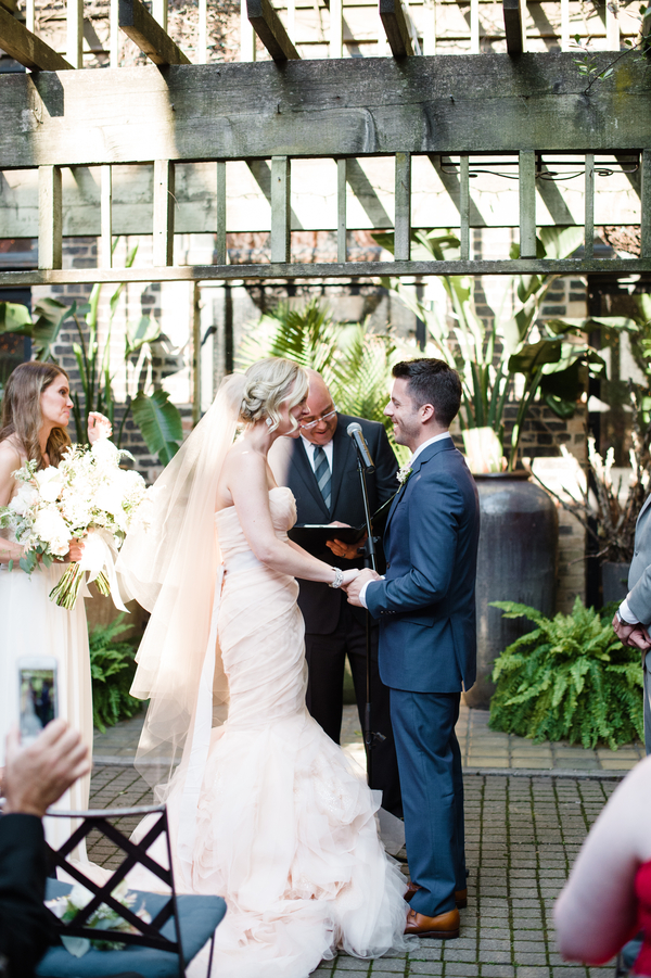 The ceremony spot was an urban garden, industrial yet green