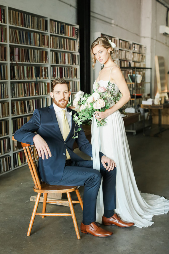 The groom was wearing a navy suit, a white shirt, cognac shoes and a neutral tie