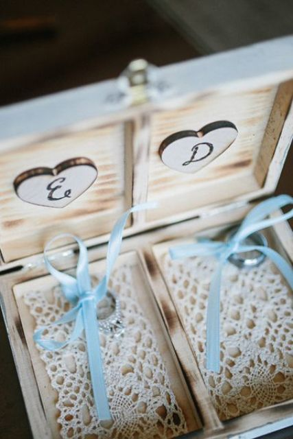 a whitewashed wooden box with crochet lace inside