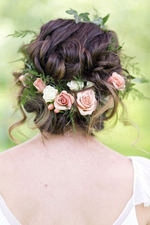 fresh garden roses and greenery tucked into the hair is a great garden-inspired idea