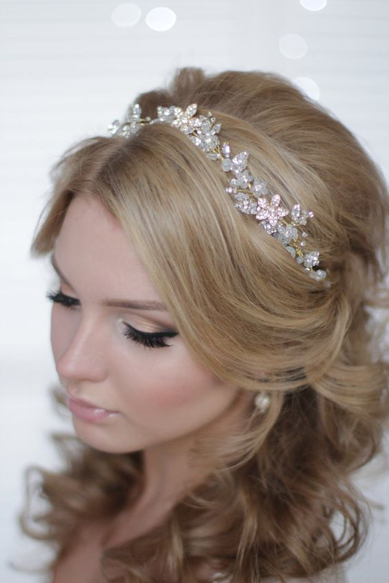 half updo with a sparkling bead bridal headpiece