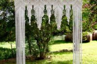 08 macrame covered wedding arch looks boho and gypsy at the same time