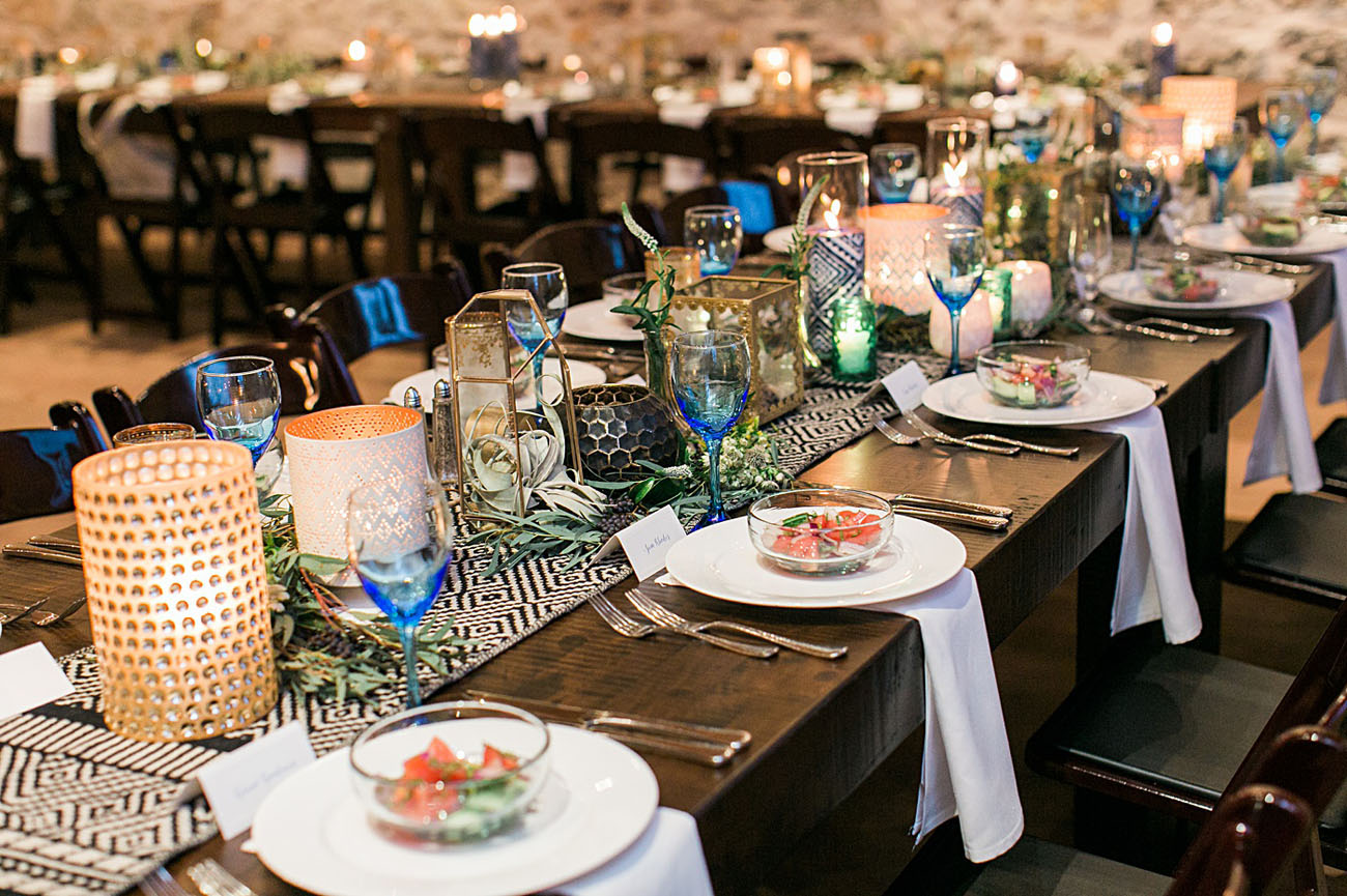 Blue glasses and green candle holders are amazing for giving the tablescapes an Eastern feel
