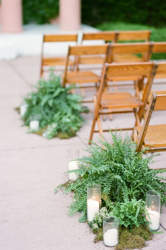 fern, moss and candles for decorating the aisle