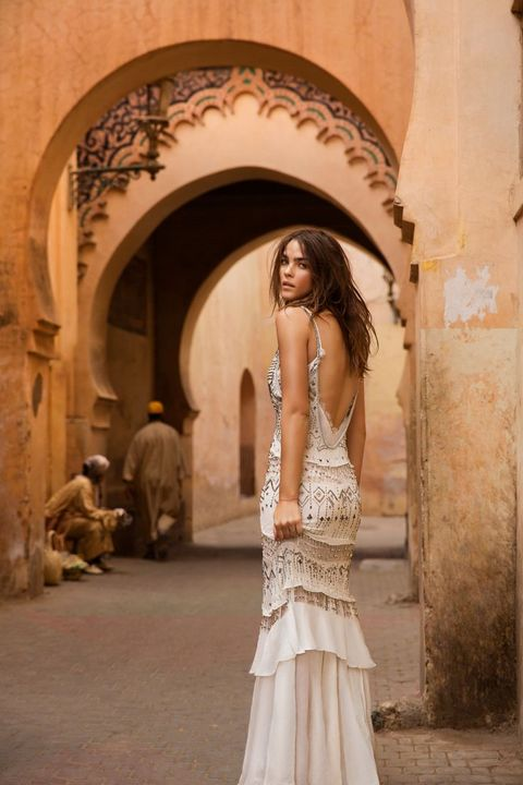 heavily beaded sparkling wedding dress with straps and a fitted silhouette