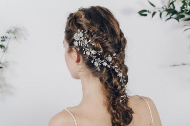 twisted and braided half updo with a crystal hair vine