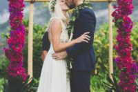 09 very bold hot pink flower wedding arch for a tropical wedding