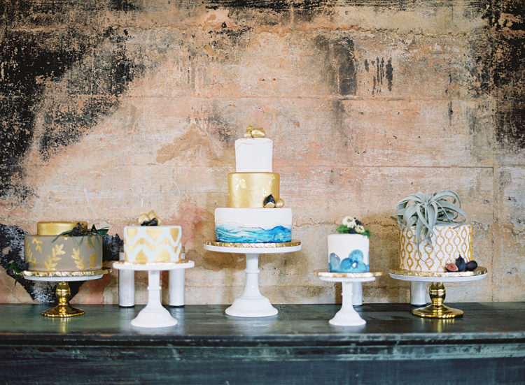 The assortment of wedding cakes was inspired by Morocco, too, with gold, blues and air plants