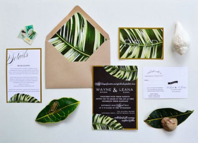 jungle-inspired wedding stationary with real leaves