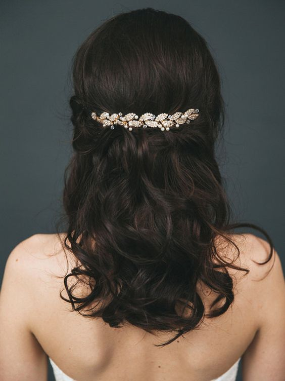 messy half updo with a gold leaf and pearl hair vine