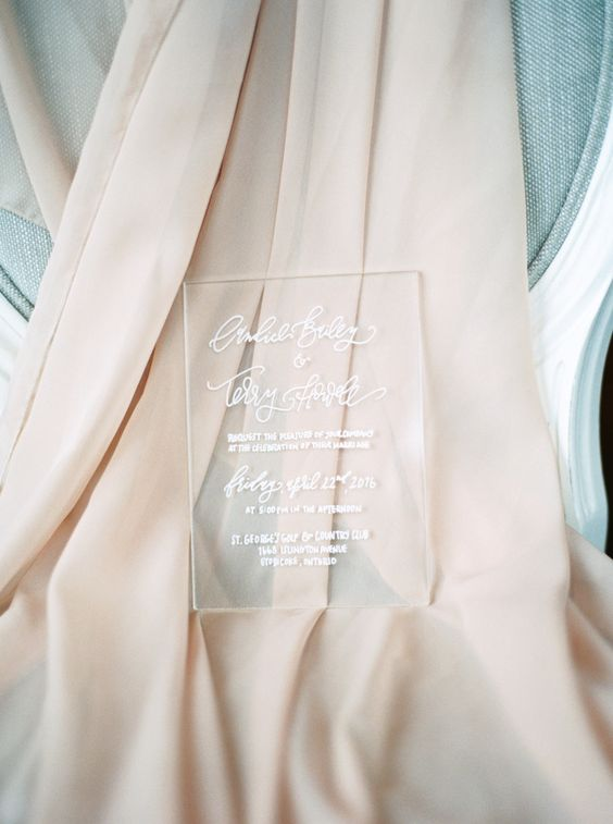 simple acrylic invitation with white calligraphy