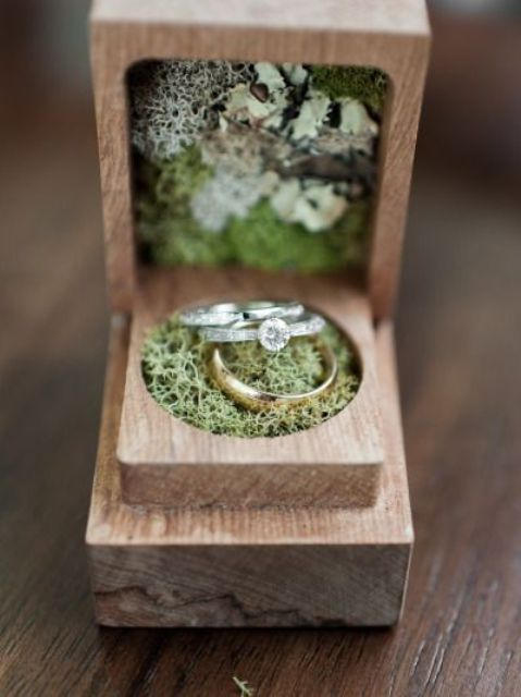 small rustic wooden ring box with moss inside