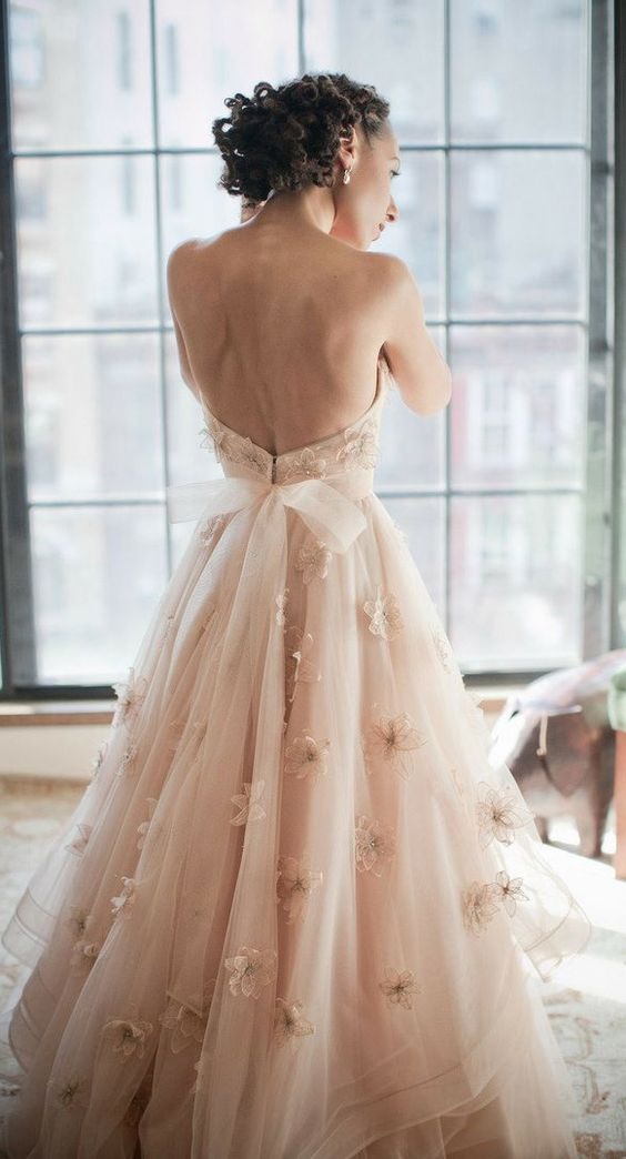 strapless blush floral applique dress with a bow