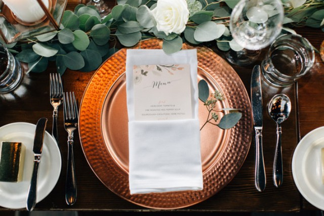 Copper platters and lanterns made the table setting cooler