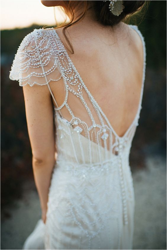 heaily embellished V cutout back wedding dress with buttons