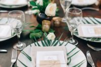 11 stylish table setting with palm leaves and neutral flowers