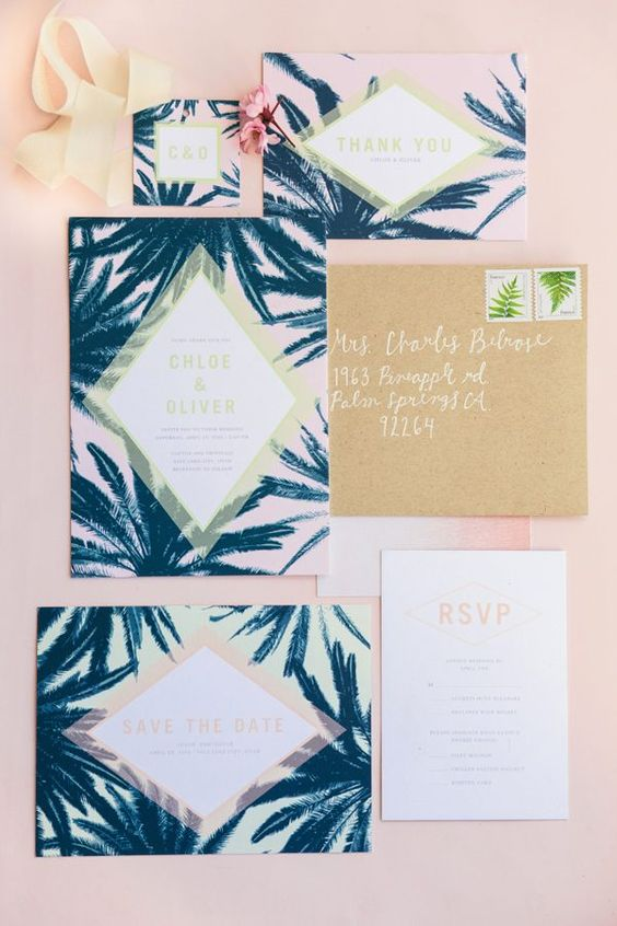tropical palm print wedding stationary with neutral envelopes